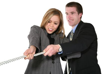 A business team playing tug of war in an intense stuggle (Focus on Woman) photo