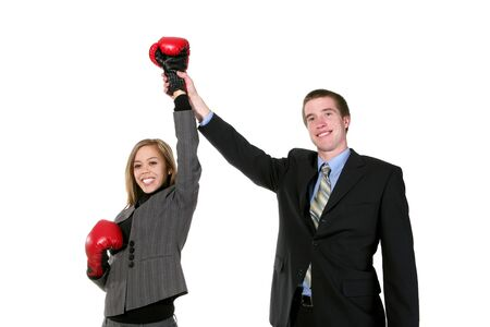 attainment: A business man raising his partners hand in success