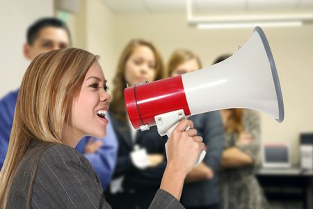 reprimand: A business woman shouting into a megaphone