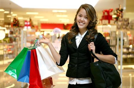 A beautiful woman holding shopping bags in the mall