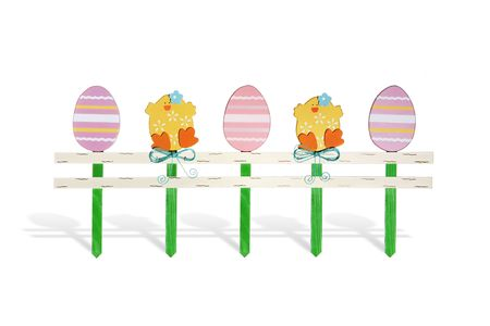 A Easter display of chicks and eggs on fence posts photo