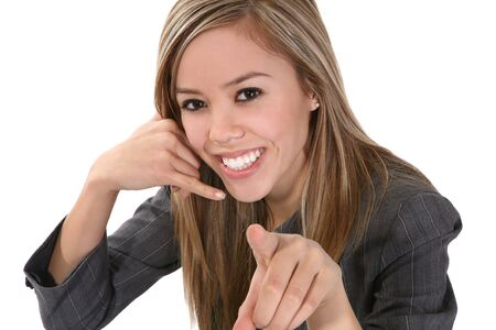 simulating: A beautiful business woman simulating a phone call