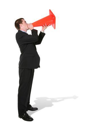 making an announcement: A handsome business man making an announcement thrugh a construction cone
