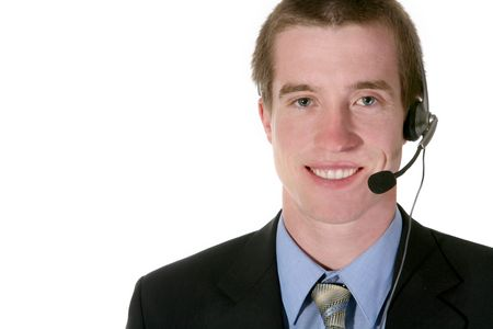 earpiece: A sales man with a telephone earpiece trying to make the sale Stock Photo