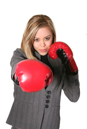 A business woman with boxing gloves punching Stock Photo - 782463
