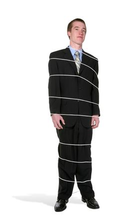 enslave: A business man in a suit tied in place with rope