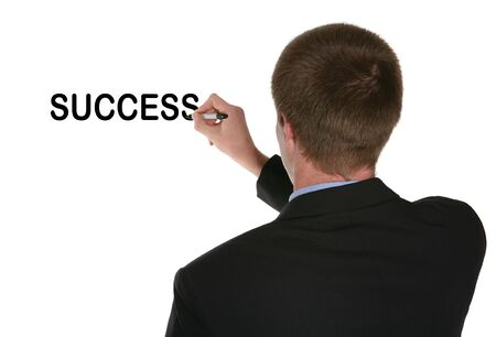 A business man writing the word success on the board Stock Photo - 782416