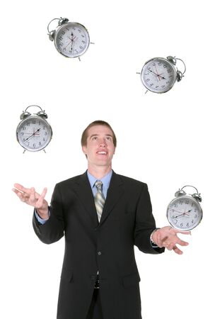 A business man juggling his time with alarm clocks Stock Photo