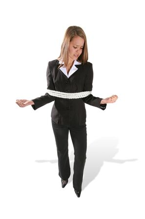 bound woman: A business woman frustrated at being tied with rope Stock Photo