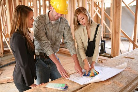 home builder: Two designers and a home builder discussing color plans