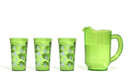 A pitcher and three glasses of green beer on Saint Patricks Day Imagens
