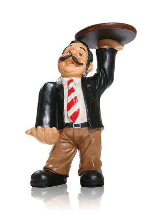 A statue of a waiter holding a tray photo