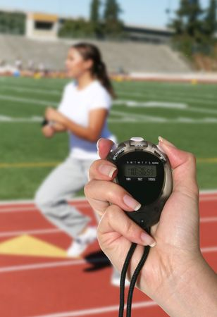 A woman holding a stopwatch isolated over white
