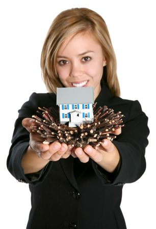 A pretty woman showing a model home in a birds nest photo