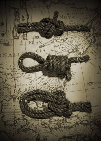 Three different knots in rope over a vintage map Stock fotó