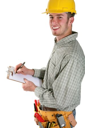 contruction: A handsome contruction worker taking noted isolated over white Stock Photo