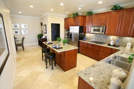 A beautiful kitchen interior inside an upscale home Фото со стока