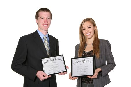 credentials: An attractive couple holding their certificates  Stock Photo