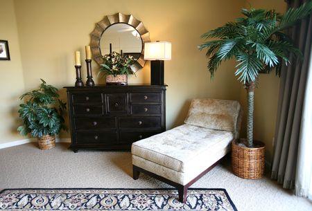 themed: A tropical themed lounge inside an upscale home