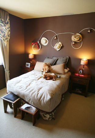blanket horse: A cowboy rodeo themed bedroom inside an upscale home