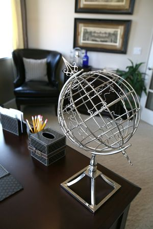 home office interior: A wire globe in an home office interior (Focus on Globe)