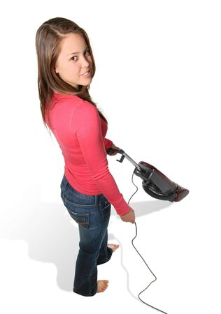 A pretty woman smiling while vacuuming isolated over white photo