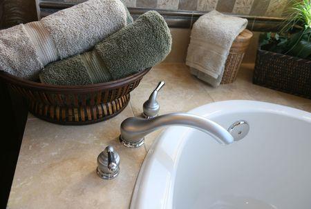 A bathtub in the bathroom of a upscale home interior