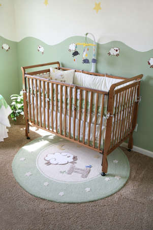 A crib in a  room inteior inside an upscale home