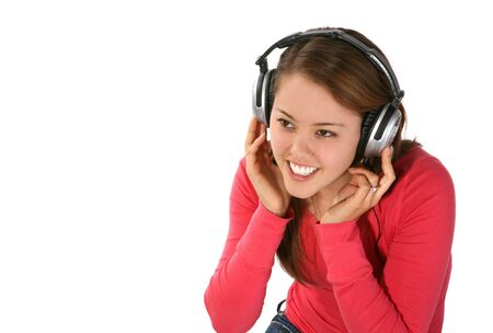 A young pretty woman listening to music isolated over white Stock Photo