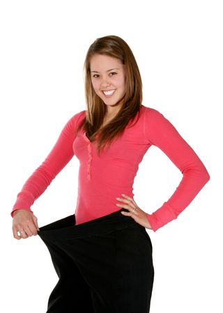 A pretty woman wearing her old pants before her weight\ loss
