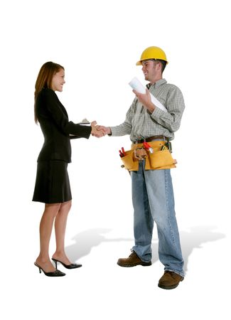 home builder: A home designer working with a home builder inspecting the blueprints