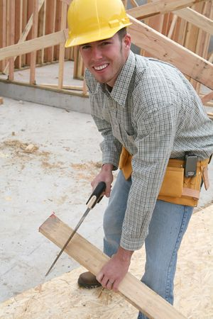 carpenter's sawdust: A man working building a home and cutting some wood Stock Photo
