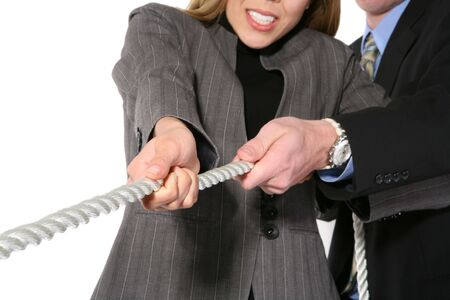 tug: A business team playing tug of war in an intense stuggle  Stock Photo