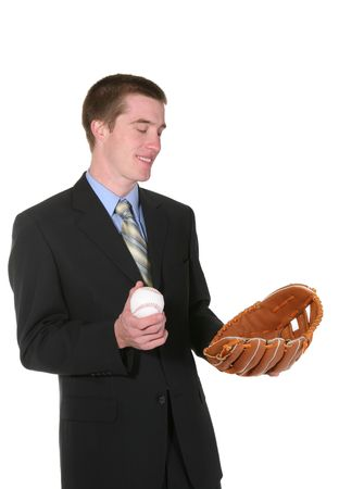 A business man with a baseball and glove yearning to play his sport photo