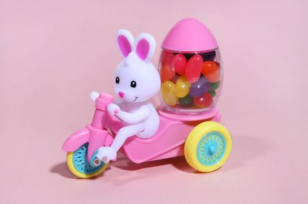jellybean: An easter bunny toy with cart and carring a load of jelly beans Stock Photo