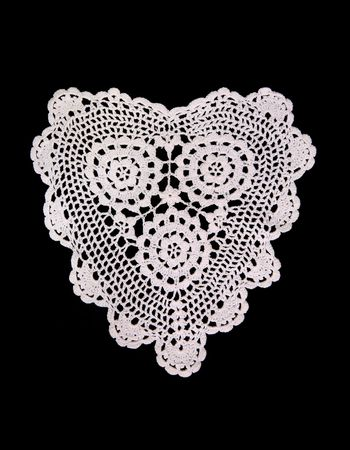 lacey: An ornate lace heart isolated over black
