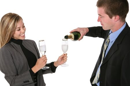 A pretty business couple celebrating a success with champagne Stock Photo - 908755