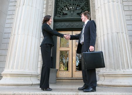 Two lawyers shaking hands outside the court building Stock Photo - 909307
