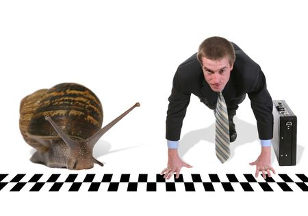 A handsome business man starting a race against a snail photo