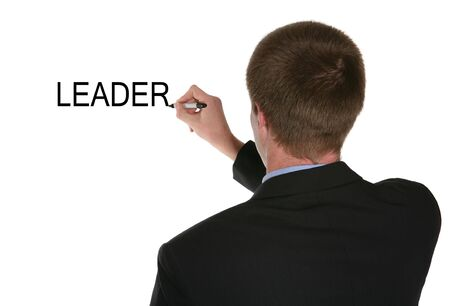 A business man writing the word leader on the board Stock Photo - 923061