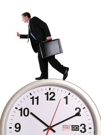 hustle: Un bel uomo d'affari in esecuzione su un grande orologio  Archivio Fotografico