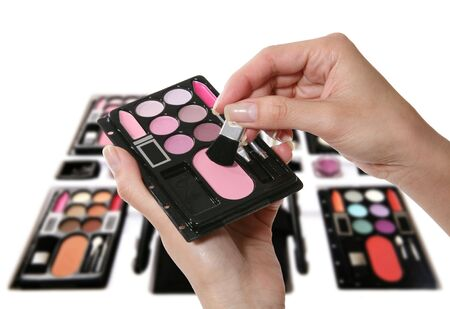 A colorful make-up (cosmetics) kit isolated over white