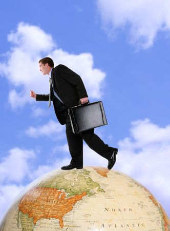 A handsome business man running on a world globe Stock Photo - 930759