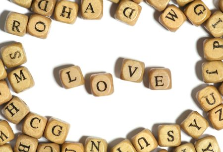 adulation: Block letters spelling the word love over white Stock Photo