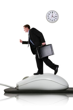 A business man running on a computer mouse photo