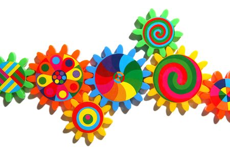Colorful gears, cogs, toothed wheels isolated over white