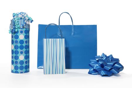 gift bags: Three blue decorative gift bags over white
