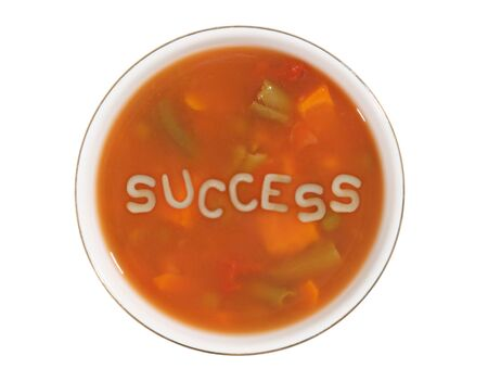 soup bowl: A bowl of alphabet soup with the word success in the middle