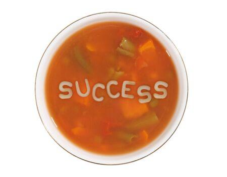 Een kom soep alfabet met het woord succes in het midden