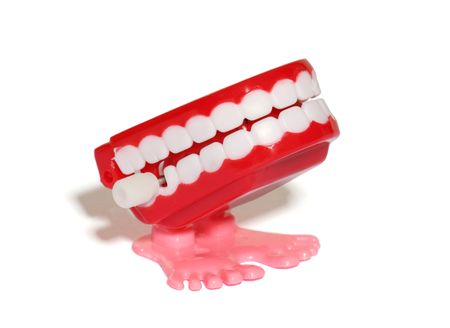 chomp: A teeth wind up toy over white